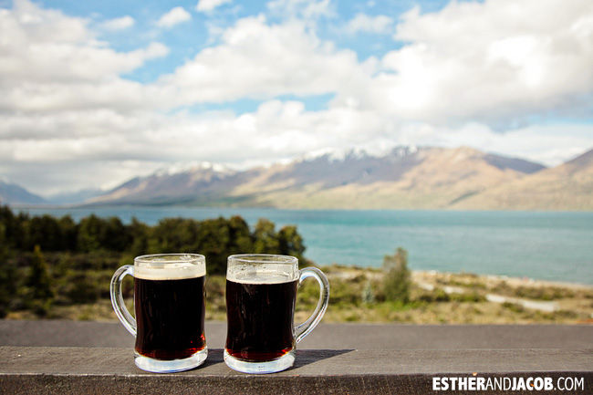 Enjoying the beer and the view at Lake Ohau Lodge New Zealand | 10 Day Guide to South Island New Zealand with Contiki.