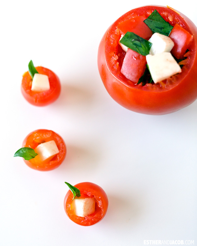 Mini stuffed caprese salad in a cherry tomato cup