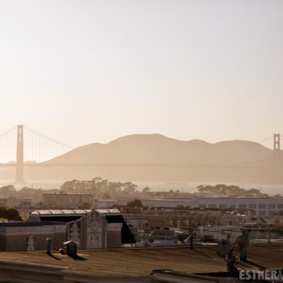 on a rooftop overlooking the golden gate bridge. san francisco