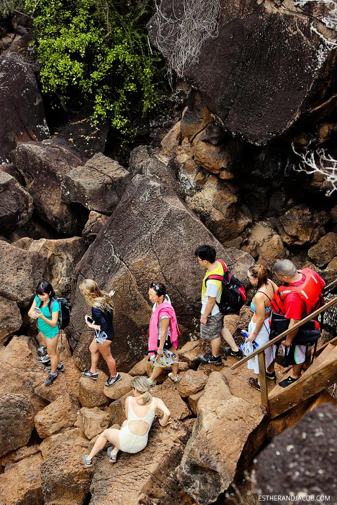 Hiking down to Las Grietas in Galapagos Islands.