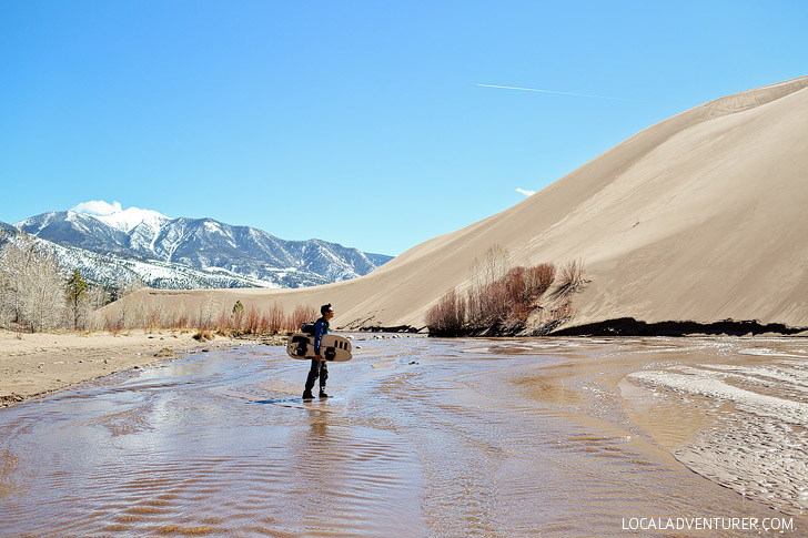 Medano Creek in Great Sand Dunes National Park Colorado - in the early summer the flow of the creek is great for tubing // localadventurer.com
