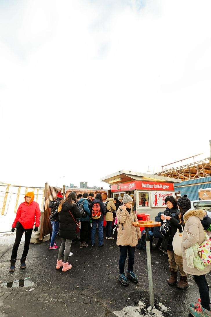 Eating an Icelandic Hotdog at Baejarins Bestu, who boasts having the best hotdog in Iceland // localadventurer.com