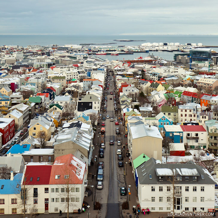 Beautiful Aerial Shot of Reykjavik Iceland from the Hallgrimskirkja Church + Iceland Road Trip Travel Tips - Planning a trip to Iceland? Take a look at this article to find out which 5 day trips from Reykjavik Iceland you can't miss. There are so many beautiful places that you need to experience // Local Adventurer #iceland #roadtrip #europe// localadventurer.com