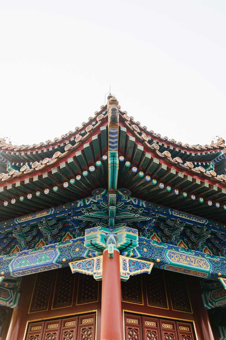 Jingshan Park Beijing China - Climb this artificial hill for an amazing view of Beijing and the Forbidden City. Be sure to visit the pavilions in the park for a close-up at Chinese architecture // localadventurer.com