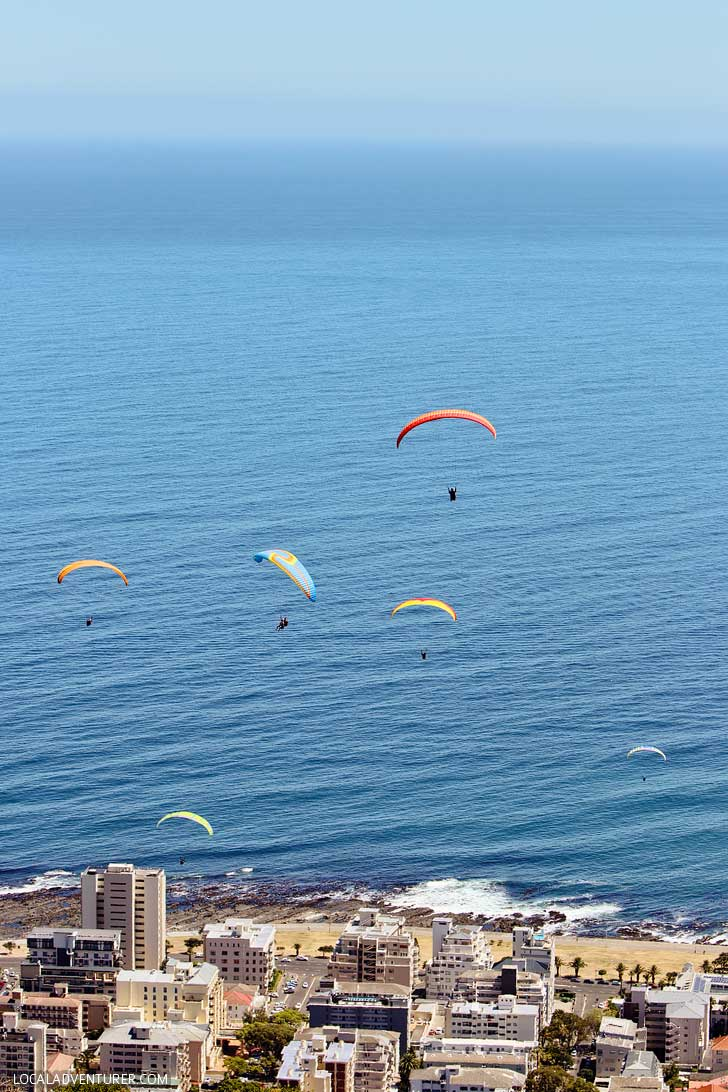Paragliding Cape Town Signal Hill - one of the best things to do in Cape Town. You get a beautiful view Signal Hill, Lions Head, Table Mountain, and the ocean // localadventurer.com