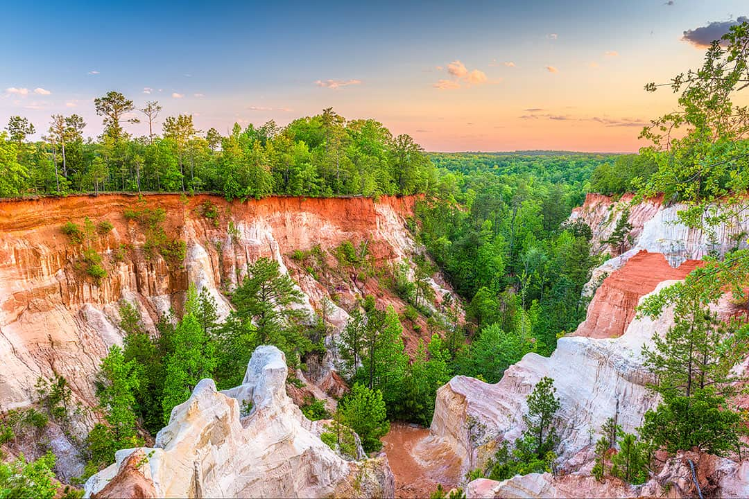"Providence Canyon State Park is also referred to as the ""Little Grand Canyon"" of Georgia. It offers the most picturesque views with tones of orange, pink, and red"