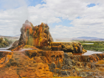 Want to visit the Fly Geyser in Gerlach Nevada? Save this pin and click through to find out how to book a rare tour of this beautiful phenomenon. Up until recently, no one was allowed to visit the fly ranch geyser property, but now that Burning Man owns it, you can go on nature walk tours to learn more the beautiful black rock desert, fly geyser tour, art installations, and the hot springs. // Local Adventurer #travelnevada #dfmi #nevada #flygeyser #blackrockdesert #desert