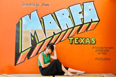 Greetings from Marfa Texas Mural in front of Frama Coffee